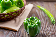 Fresh raw green organic Bell Pepper close up. On a wooden background Royalty Free Stock Photos