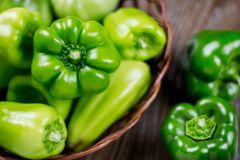 Fresh raw green organic Bell Pepper close up. On a wooden background Stock Photo