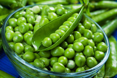 Fresh raw green peas. In glass bowl Stock Photo