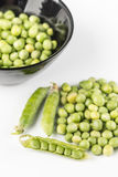 Fresh raw green peas in the bowl  over white background.  Stock Images