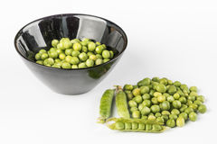 Fresh raw green peas in the bowl  over white background.  Royalty Free Stock Images