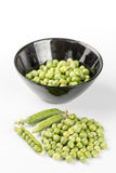 Fresh raw green peas in the bowl  over white background.  Royalty Free Stock Image