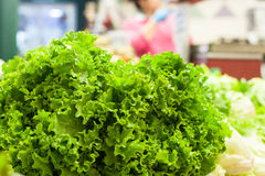 Fresh raw green salad  in market. With out of focus background Stock Photo