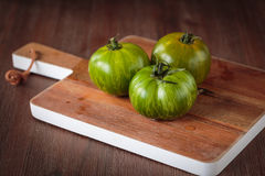 Fresh raw green tomatoes. Delicious fresh raw green tomatoes for an healthy meal Stock Photo
