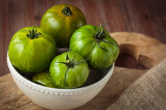 Fresh raw green tomatoes. Delicious fresh raw green tomatoes for an healthy nutrition Royalty Free Stock Photo