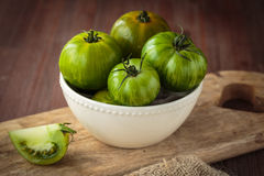 Fresh raw green tomatoes. Delicious fresh raw green tomatoes for an healthy nutrition Stock Images