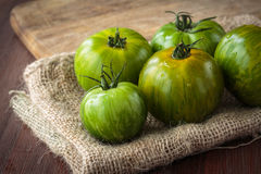Fresh raw green tomatoes. Delicious fresh raw green tomatoes for an healthy nutrition Royalty Free Stock Photos