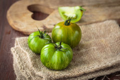 Fresh raw green tomatoes. Delicious fresh raw green tomatoes for an healthy nutrition Stock Photography