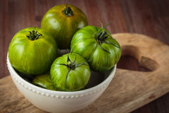 Fresh raw green tomatoes. Delicious fresh raw green tomatoes for an healthy nutrition Royalty Free Stock Image