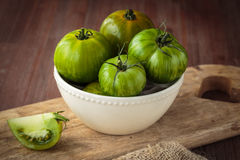 Fresh raw green tomatoes. Delicious fresh raw green tomatoes for an healthy nutrition Royalty Free Stock Photography