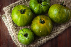 Fresh raw green tomatoes. Delicious fresh raw green tomatoes for an healthy nutrition Royalty Free Stock Images