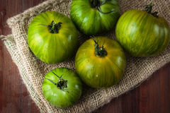 Fresh raw green tomatoes. Delicious fresh raw green tomatoes for an healthy nutrition Stock Image