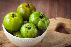 Fresh raw green tomatoes. Delicious fresh raw green tomatoes for an healthy nutrition Stock Photos
