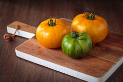 Fresh raw green and yellow tomatoes. Delicious fresh raw green and yellow tomatoes for an healthy meal Stock Photo