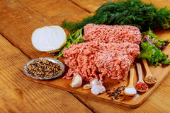 Fresh raw ground beef on a paper on rustic wooden table. Fresh raw ground beef on a paper on a rustic wooden table Stock Image