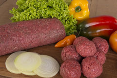 Fresh Raw ground Meat. Table with raw ground Meat with Ingredients Stock Photos