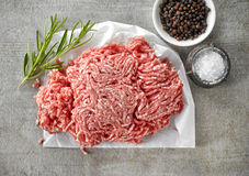 Fresh raw ground pork. Heap and spices, top view Royalty Free Stock Image