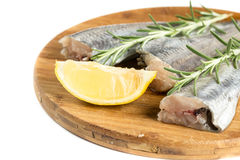 Fresh raw hake with lemon and rosemary branches.  Stock Photos