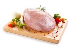 Fresh raw ham. On cutting board Stock Image