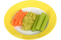 Fresh Raw Healthy Vegetables with Guacamole Dip. On a plate isolated white background Stock Photography