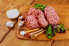 Fresh raw home-made minced beef steak burger with spices,. Fresh homemade raw minced beef for hamburgers with spices on the table Royalty Free Stock Photos