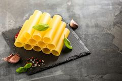 Fresh raw homemade Connelloni PASTA on Dark Table. royalty free stock image