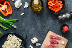 Fresh raw ingredients for cooking Asian spicy pork on dark background. Top view, copy space Royalty Free Stock Photo
