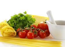 Fresh raw ingredients for making pasta. With sause over white background Stock Photo