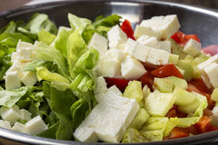 Fresh raw ingredients and romanian cheese telemea for salad. Fresh raw ingredients and romanian white cheese telemea for salad in bowl Royalty Free Stock Photo