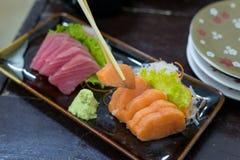 Fresh raw Japanese food Sushi and Sashimi. Japanese cuisine Royalty Free Stock Photos