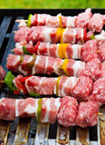 Fresh raw kebab. With veggies ready to be cooked Stock Photo
