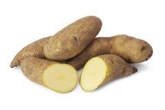 Fresh raw kipfler  potatoes. Fresh raw kipfler potatoes isolated on white background Royalty Free Stock Photos