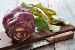 Fresh raw kohlrabi. With knife on wooden background Stock Photography