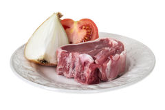 Fresh Raw Lamb Chop with Raw Onion and Fresh Tomato Royalty Free Stock Photography