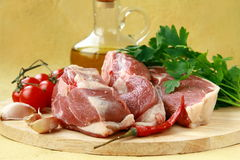 Fresh raw lamb with olive oil with parsley. And pepper on the board Stock Photography