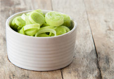 Fresh raw leek slice in a bowl in wooden background. Close up Royalty Free Stock Photography