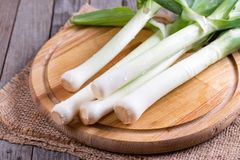 Fresh raw leek on a wooden table. On a wooden background Royalty Free Stock Photography