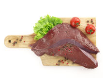 Fresh raw liver. On cutting board isolated on white background Stock Photos