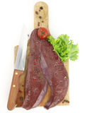 Fresh raw liver. On cutting board isolated on white background Stock Images