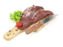 Fresh raw liver. On cutting board isolated on white background Stock Photo