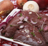 Fresh raw liver. Some fresh raw liver with spices Stock Image