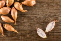 Free Fresh Raw Long Shallot Onion On Brown Wood Stock Photography - 118696642