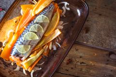 Fresh raw mackerel with vegetables and slices of lime Royalty Free Stock Photos