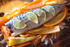 Fresh raw mackerel with vegetables and slices of lime Royalty Free Stock Image