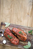 Fresh Raw Marinated Meat on a Wooden Table. Stock Images