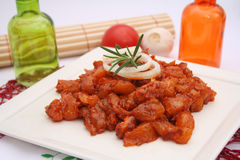Fresh raw marinated pork on a plate. Fresh raw marinated pork Royalty Free Stock Image
