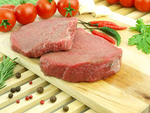 Fresh raw meat. Filet on wooden background Stock Photos