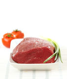 Fresh raw meat. On white plate Royalty Free Stock Images