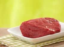 Fresh raw meat. On white plate Royalty Free Stock Image