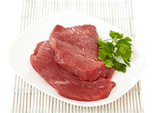 Fresh raw meat. On white plate Stock Photo